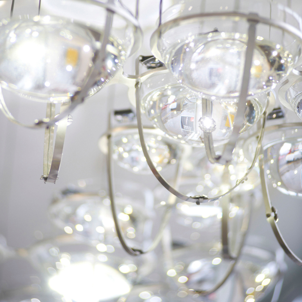 an interactive water and light fitting pools of rippling light are formed on the ceiling by the lensing affects of suspended crystal bowls agitated by